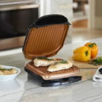 The Fat Draining Grill - An indoor grill with unique cooking plate designed to drain away excess fat